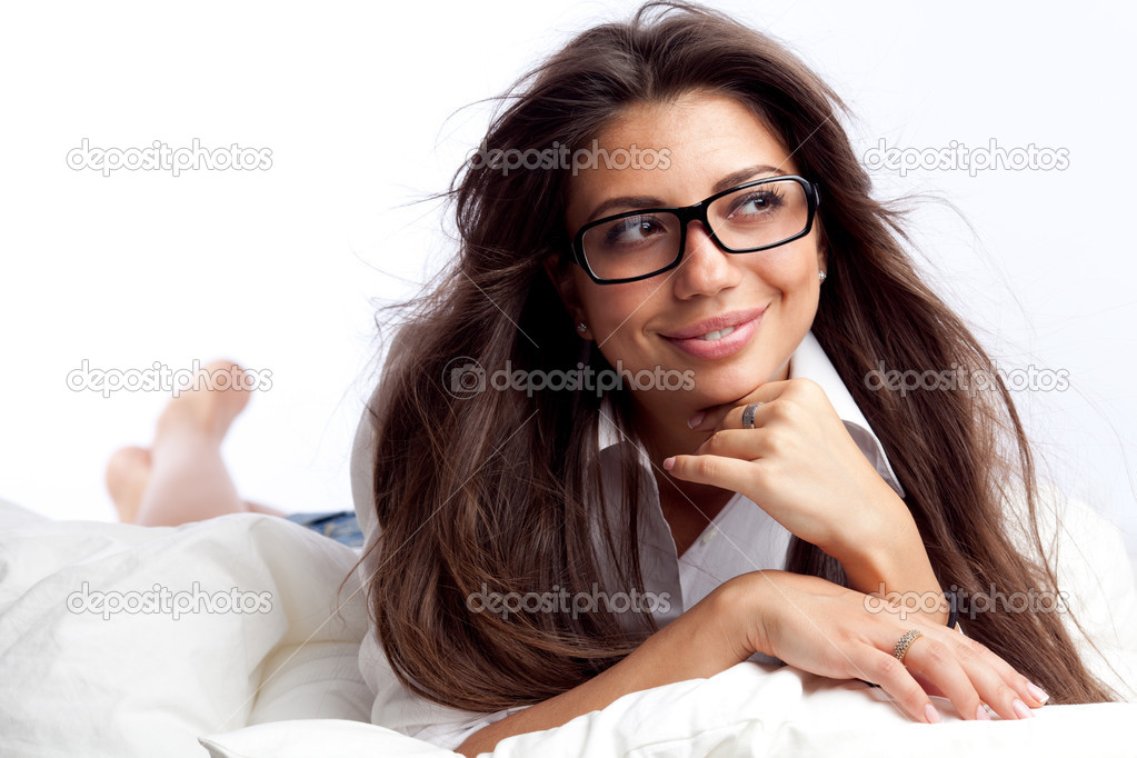 Young woman lying in the bed — Stock Photo #6813093
