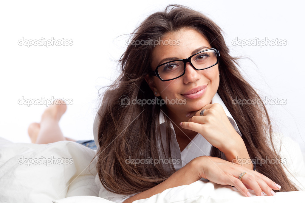 Young woman lying in the bed — Stock Photo #6813095