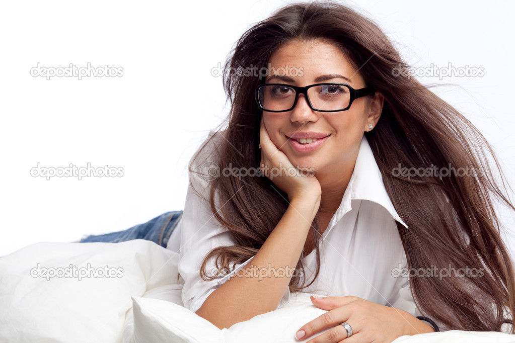 Young woman lying in the bed — Stock Photo #6813096