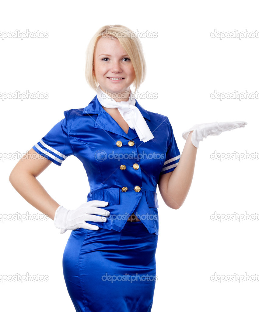 Beautiful stewardess. Holding in hand something. — Stock Photo #6813366