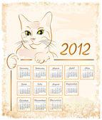 Cat showing vintage calendar 2012 — Stock Vector