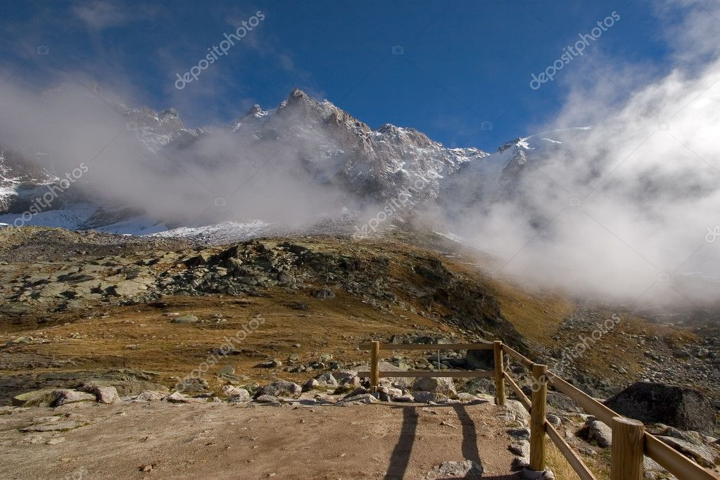 A panorama of Mont Blanc in easy clouds, and a high-mountainous meadow   — Stock Photo #6840958
