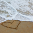 On the sand drawn by heart — Stock Photo