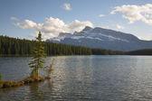 Silent evening on mountain lake. — Stock Photo