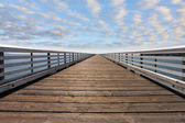 Wooden pier with handrails — Stock Photo