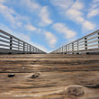 Wooden pier with a handrail on Pacific coast - ストック写真