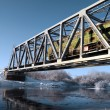 Railway bridge through small river — Stock Photo #6882378
