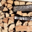 Firewood near building — Stock Photo