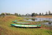 Small boats on coast river — Stock Photo