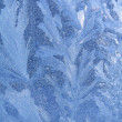 Blue ice on winter window — Stock Photo