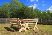 Garden furniture on green glade — Stock Photo
