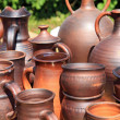 Stock Photo: Clay pitchers on rural market