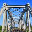 Railway bridge through small river — Foto Stock