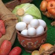 Varied food-stuffs on rural market — Stock Photo
