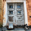 Stock Photo: Aging door in destroyed house