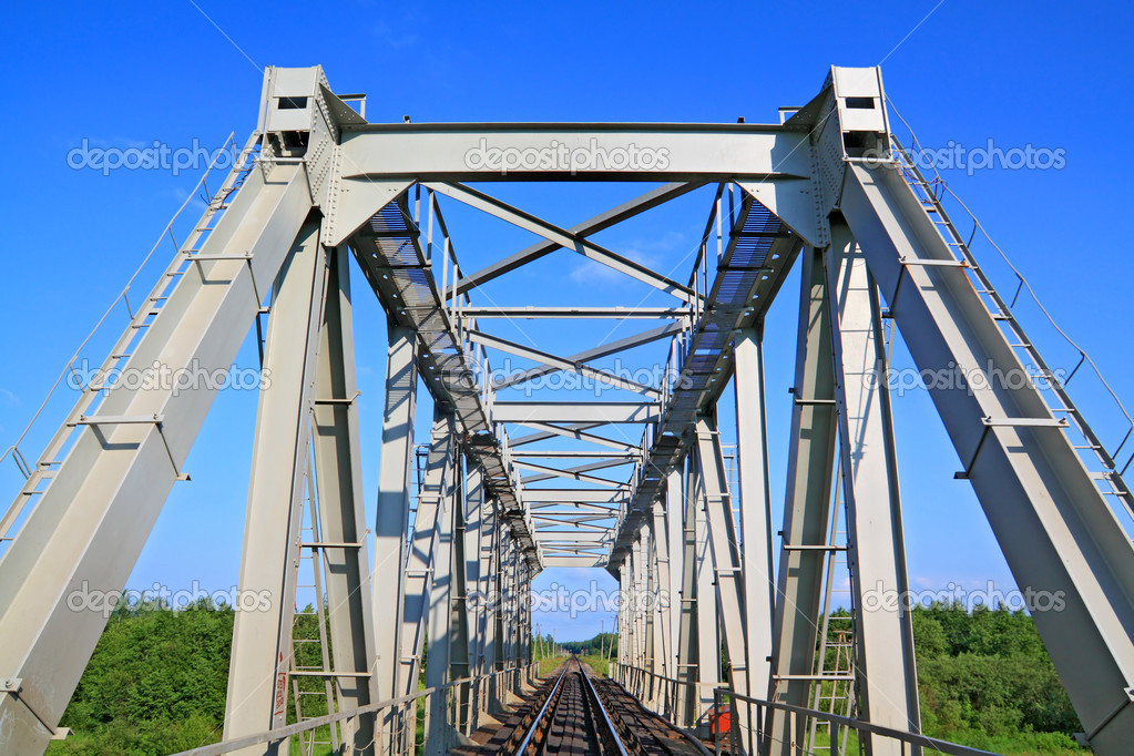 Railway bridge through small river — Stock Photo #6912692