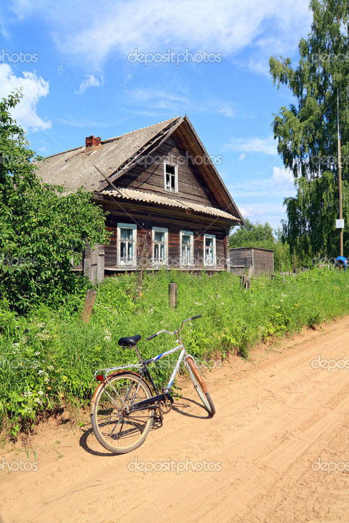 Old bicycle on rural road  Stock Photo #6912921