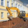 Excavator near townhouse — Stock Photo