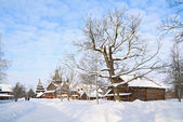 Old farmhouse amongst white snow — Stock Photo