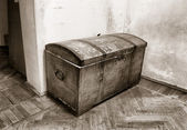 Old coffer on dirty floor — Stock Photo
