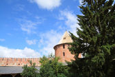 Tower to old-time fortress on celestial background — Photo