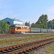 Passenger train on railway station — Stock Photo