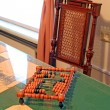 Wooden abacus on green table — Stock Photo #7027535