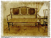 Old-time furniture on grunge background — Stock Photo
