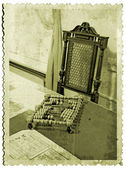 Wooden abacus on old photography — Stock Photo