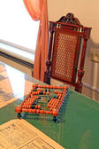 Wooden abacus on green table — Stock Photo