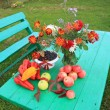 Autumn still life on green table — Stock Photo