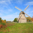 Aging mill on autumn meadow — Stock Photo #7097915