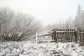 Old fence in snow — Stock Photo