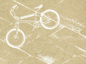 Bicycle on grunge background — Stock Photo