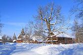 Wooden chapel in winter village — Stock Photo