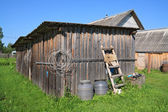 Rural shed on green herb — Stock Photo