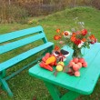 Autumn still life on garden table — Stock Photo