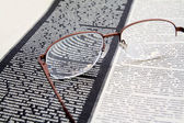 Spectacles on newspaper — Stock Photo