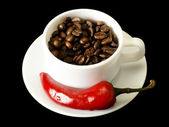 Coffee and red pepper — Stock Photo