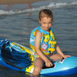 Child on an inflatable mattress in the sea. — Stock Photo