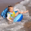 Child rides a wave of the sea. — Stock Photo #6883565