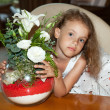 Royalty-Free Stock Photo: Little girl with bouquet of flowers.
