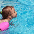 Joyful little girl swimming in the pool. — Stock Photo #7154166