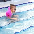 Joyful little girl swimming in the pool. — Stock Photo #7154174