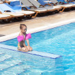 Little girl on the side of the pool. — Stock Photo #7154182