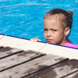 Upset little girl swimming in the pool. — Stock fotografie
