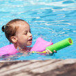 Joyful little girl swimming in the pool. — Stok fotoğraf