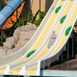Man riding a water slide — Stock Photo