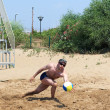 Man playing volleyball on the beach — Stock Photo