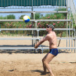 Stock Photo: Man playing volleyball on the beach